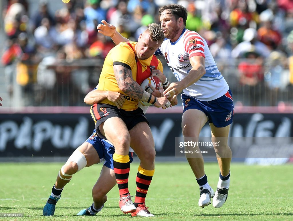 Luke Page of Papua New Guinea takes on the defence during the 2017 Rugby League World Cup match between Papua New Guinea and the United States on November 12, 2017 in Port Moresby, Papua New Guinea.