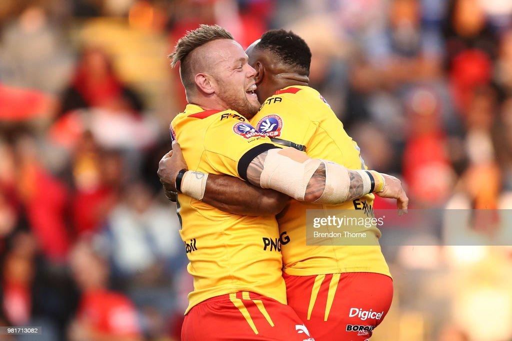 Luke Page of PNG celebrates with team mates after scoring a try during the 2018 Pacific Test Invitational match between Fiji and Papua New Guinea at Campbelltown Sports Stadium on June 23, 2018 in Sydney, Australia.
