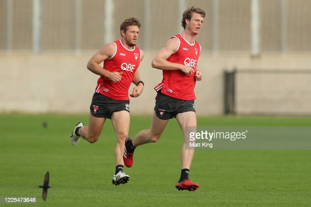 Luke Parker and Nick Blakey run during a Sydney Swans AFL training session at Lakeside Oval on May 18, 2020 in Sydney, Australia.