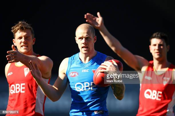 Luke Parker and Zac Jones appeal to the coaching staff after winning a drill during a Sydney Swans AFL training session at Sydney Cricket Ground on...