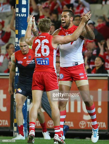 Luke Parker is congratulated by Lance Franklin of the Swans after kicking a goal during the round six AFL match between the Melbourne Demons and the...