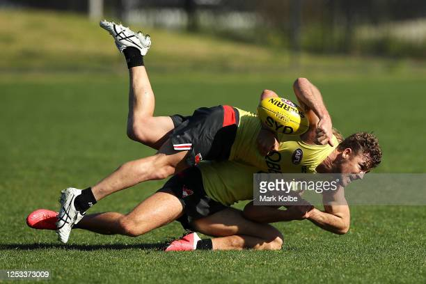 Luke Parker is tackled by James Rowbottom during a Sydney Swans AFL training session at Lakeside Oval on June 30, 2020 in Sydney, Australia.