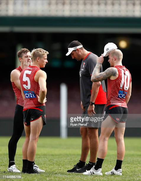 Luke Parker Isaac Heeney and Zak Jones of the Swans speak with Swans Ruck coach Dean Cox during a Sydney Swans AFL training session at the Sydney...