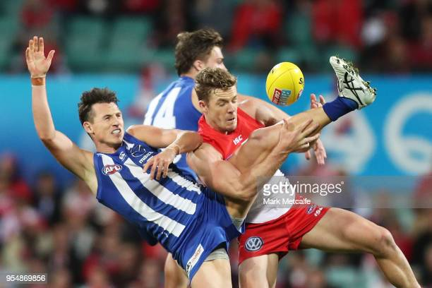 Luke Parker of the Swans and Ben Jacobs of the Kangaroos compete for a mark during the round seven AFL match between the Sydney Swans and the North...