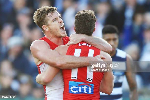 Luke Parker of the Swans celebrates a goal by Tom Papley of the Swans during the round six AFL match between the Geelong Cats and Sydney Swans at...