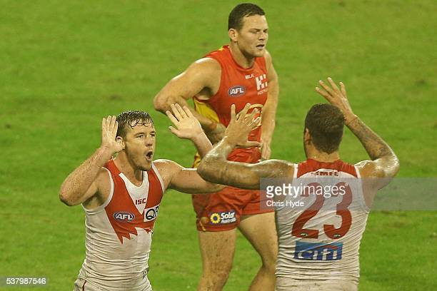Luke Parker of the Swans celebrates a goal during the round 11 AFL match between the Gold Coast Suns and the Sydney Swans at Metricon Stadium on June...