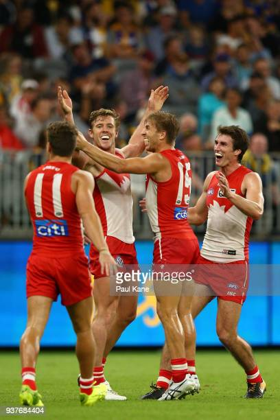 Luke Parker of the Swans celebrates a goal during the round one AFL match between the West Coast Eagles and the Sydney Swans at Optus Stadium on...