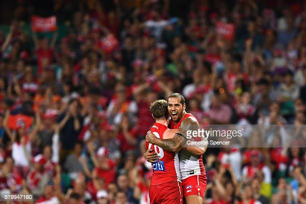 Luke Parker of the Swans celebrates kicking a goal with team mate Lance Franklin during the round three AFL match between the Sydney Swans and the...