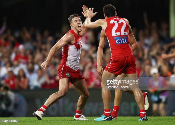Luke Parker of the Swans celebrates kicking a goal with team mates during the round three AFL match between the Sydney Swans and the Greater Western...
