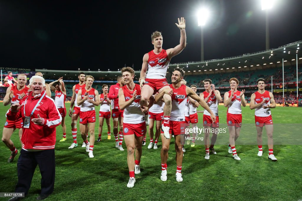 Luke Parker of the Swans celebrates victory with team mates and is chaired from the pitch after playing his 150th match during the AFL Second Elimination Final match between the Sydney Swans and the Essendon Bombers at Sydney Cricket Ground on September 9, 2017 in Sydney, Australia.