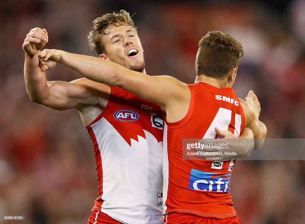Luke Parker of the Swans (left) celebrates with Tom Papley of the Swans during the 2016 AFL Second Preliminary Final match between the Geelong Cats and the Sydney Swans at the Melbourne Cricket Ground on September 23, 2016 in Melbourne, Australia.