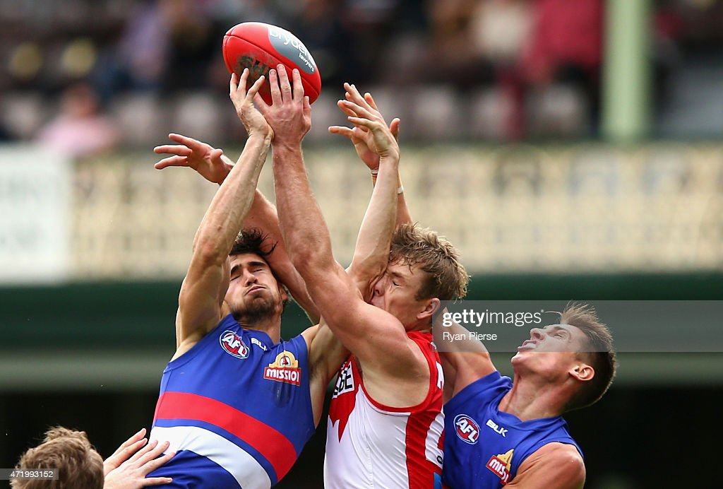 Luke Parker of the Swans competes for the ball against Easton Wood and Michael Talia of the Bulldogs during the round five AFL match between the Sydney Swans and the Western Bulldogs at SCG on May 2, 2015 in Sydney, Australia.