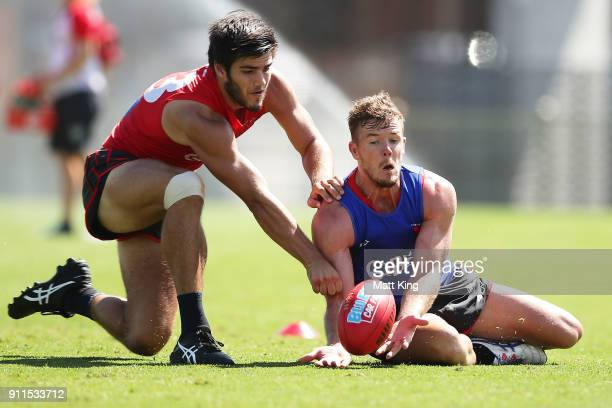 Luke Parker of the Swans is challenged by Lewis Melican of the Swans during the Sydney Swans AFL preseason training session at Lakeside Oval on...