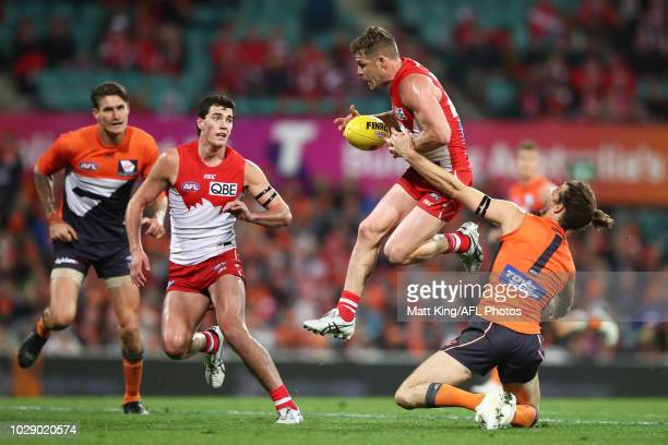 Luke Parker of the Swans is challenged by Phil Davis of the Giants during the AFL Second Elimination Final match between the Sydney Swans and the GWS...