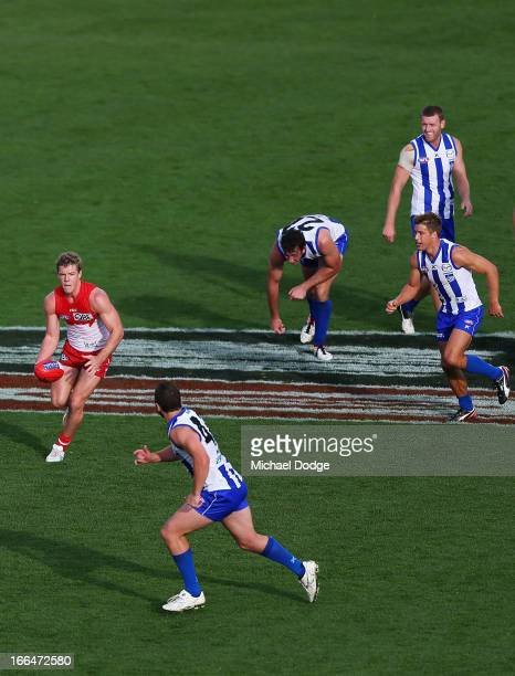 Luke Parker of the Swans runs away with the ball during the round three AFL match between the North Melbourne Kangaroos and the Sydney Swans at...