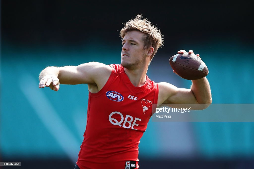 Luke Parker of the Swans throws an American football during a Sydney Swans AFL training session at Sydney Cricket Ground on September 13, 2017 in Sydney, Australia.