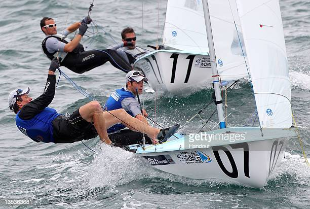 Luke Patience and Stuart Bithell of Great Britain and Nic Asher and Elliot Willis of Great Britain round the weather mark on day 7 during the mens...