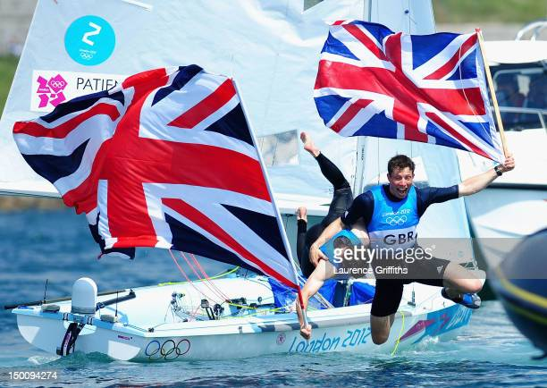 Luke Patience and Stuart Bithell of Great Britain celebrate finishing second and winning the silver medal in the Men's 470 Sailing on Day 14 of the...