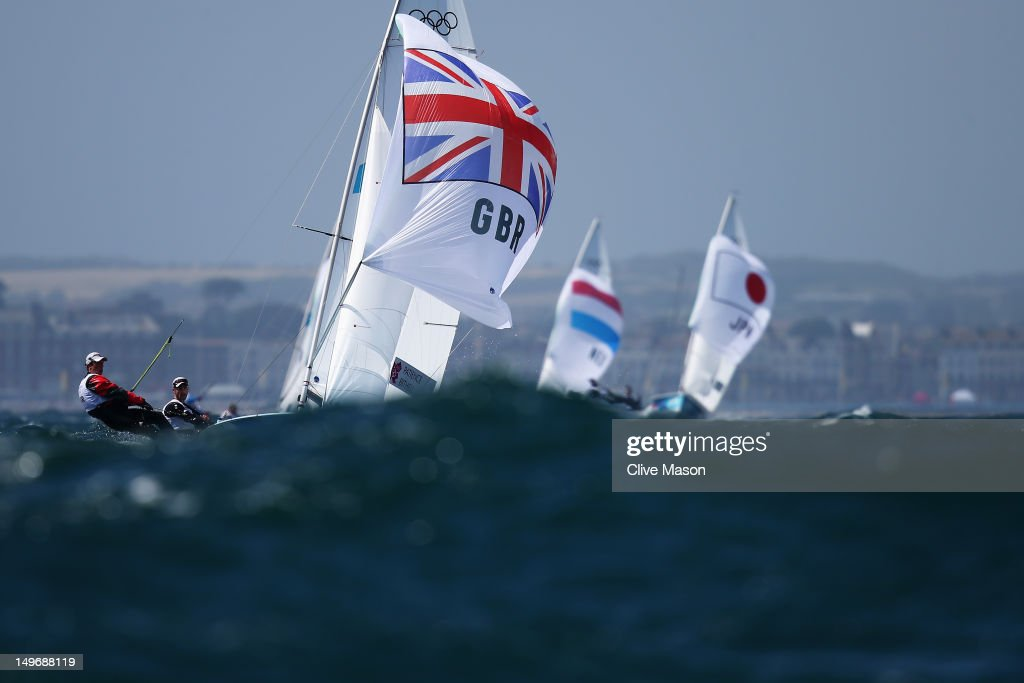 Luke Patience (black) and Stuart Bithell (red) of Great Britain compete in the Men's 470 Sailing on Day 6 of the London 2012 Olympic Games at the Weymouth & Portland Venue at Weymouth Harbour on August 2, 2012 in Weymouth, England.