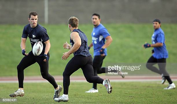 Luke Patten of Canterbury Bulldogs feeds a pass to Brett Oliver during a training session at South Leeds Stadium on February 1 2005 in Leeds England