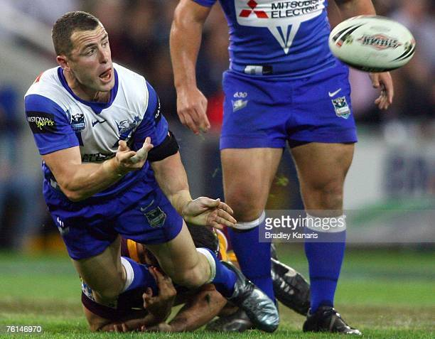 Luke Patten of the Bulldogs passes the ball during the round 23 NRL match between the Brisbane Broncos and the Bulldogs at Suncorp Stadium on August...