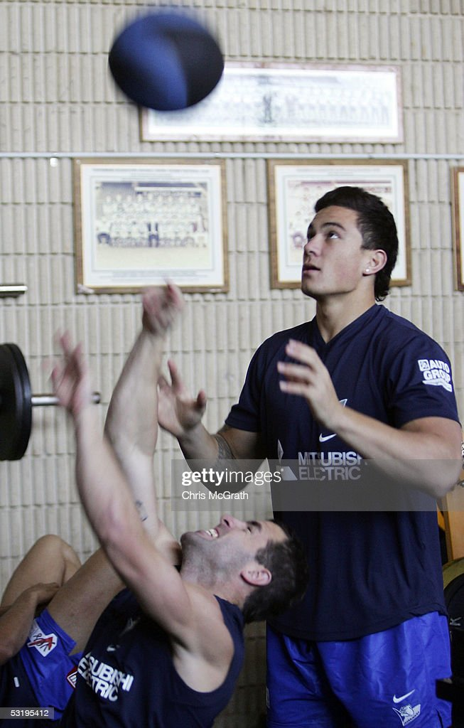 Luke Patten throws a medicine ball as Sonny Bill Williams watches on during the Bulldogs weights session held at Belmore Sportsground July 5, 2005 in Sydney, Australia