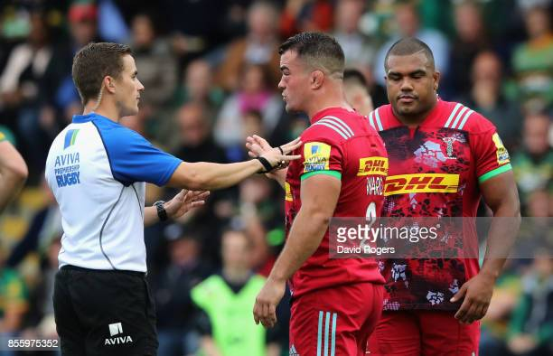 Luke Pearce the referee talks to Harlequins captain Dave Ward as a penalty is awarded against Kyle Sinckler during the Aviva Premiership match...
