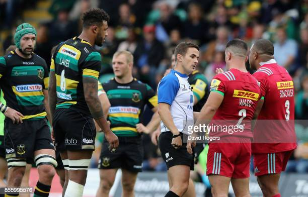 Luke Pearce, the referee talks to Harlequins captain Dave Ward as a penalty is awarded against Kyle Sinckler for an alleged eye guaging on...