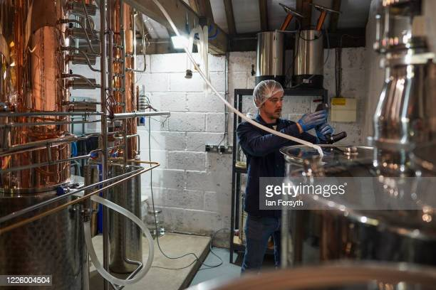 Luke Pentith checks the strength as he prepares a new batch of sanitising hand rub at the Whitby Gin distillery on May 20, 2020 in York, United...