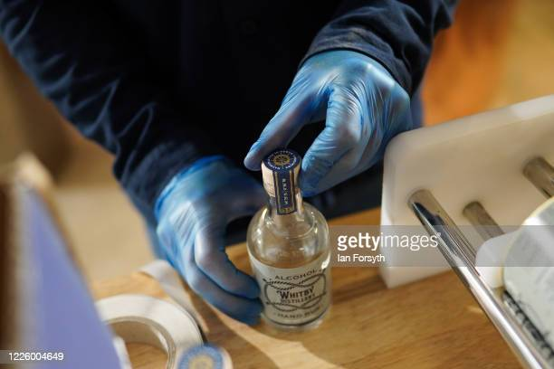 Luke Pentith prepares a new batch of sanitising hand rub at the Whitby Gin distillery on May 20, 2020 in York, United Kingdom. The North Yorkshire...