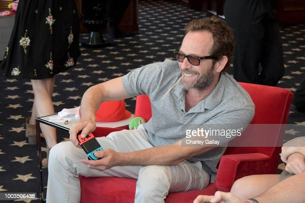 Luke Perry puts his gaming skills to the test playing Mario Kart 8 Deluxe on Nintendo Switch at the Variety Studio at ComicCon 2018 on July 21 2018...
