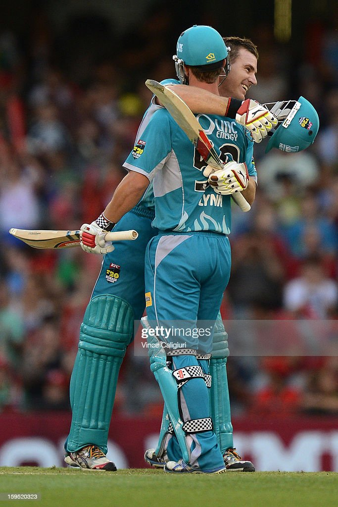 Luke Pomersbach of the Heat celebrates his century with teammate Chris Lynn during his not out innings of 112 during the Big Bash League Semi-Final match between the Melbourne Renegades and the Brisbane Heat at Etihad Stadium on January 15, 2013 in Melbourne, Australia.