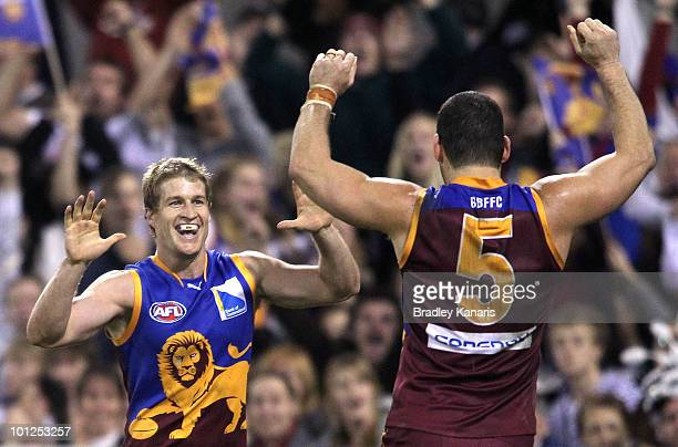 Luke Power and Brendan Fevola of the Lions celebrate after a goal during the round 10 AFL match between the Brisbane Lions and the Collingwood...