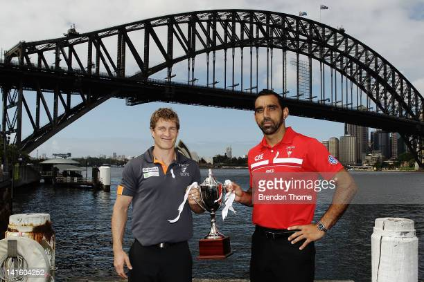 Luke Power of the Giants and Adam Goodes of the Swans pose with the Sydney Derby Trophy during the launch of the Sydney Derby trophy at Luna Park on...