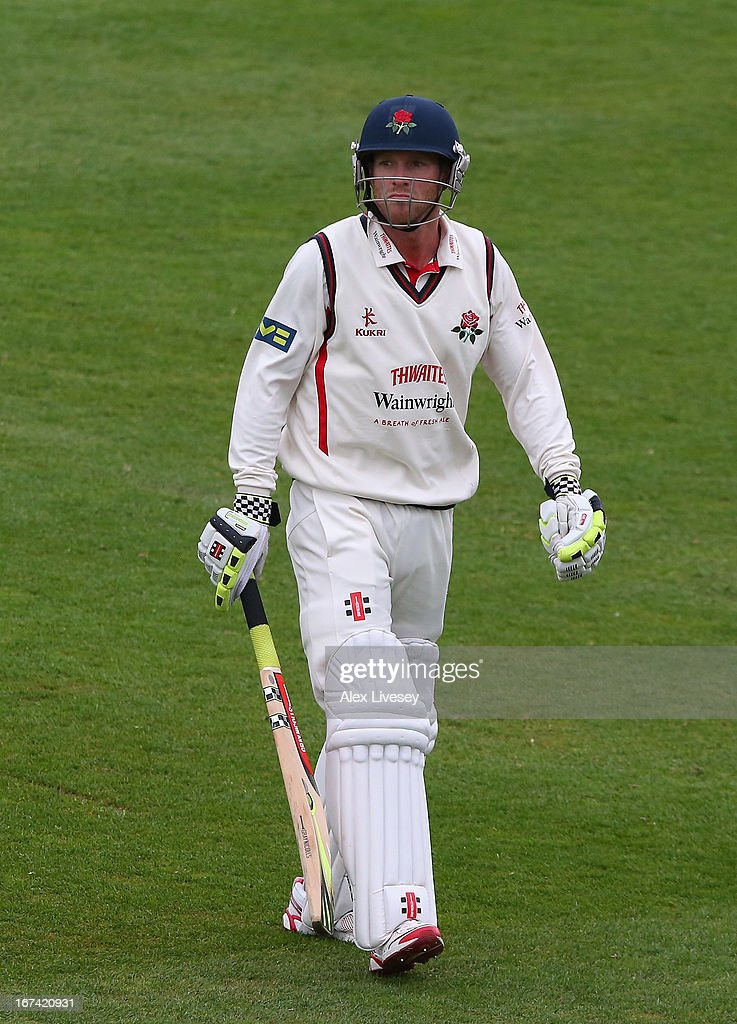Luke Procter of Lancashire walks from the field after being caught by James Tredwell and bowled by Darren Stevens of Kent during the LV County Championship Division Two match between Lancashire and Kent at Emirates Old Trafford on April 25, 2013 in Manchester, England.