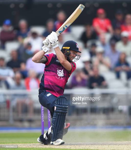 Luke Procter of Northamptonshire hits out during the Royal London One Day Cup match between Lancashire and Northamptonshire at Emirates Old Trafford...