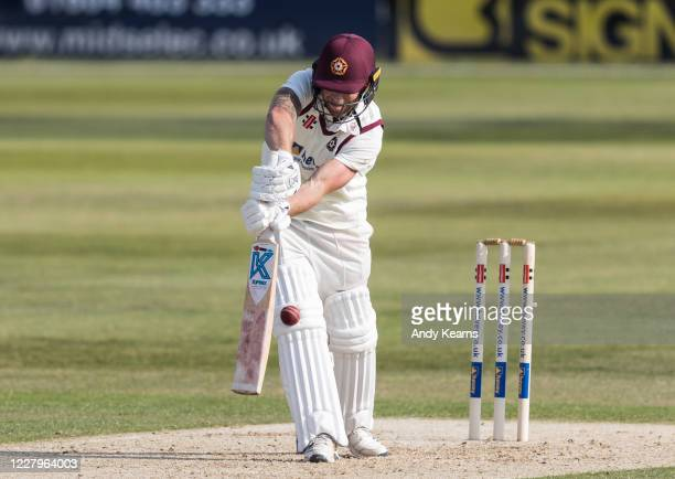 Luke Procter of Northamptonshire is trapped lbw by a delivery from Josh Davey of Somerset during day one of the Bob Willis Trophy match between...