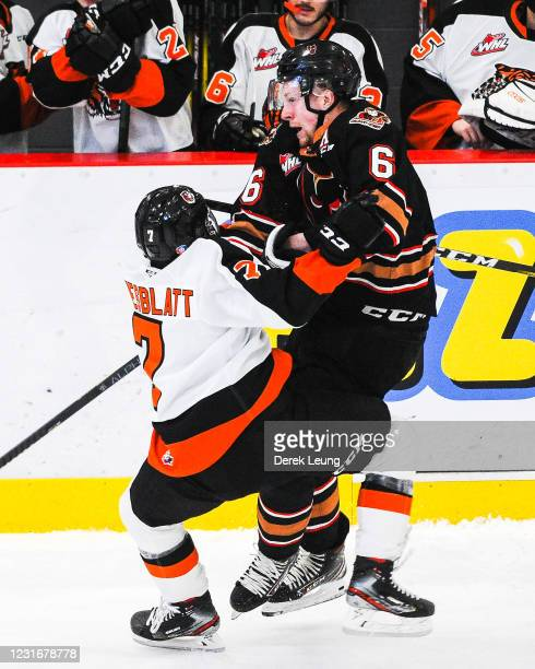 Luke Prokop of the Calgary Hitmen collides with Oasiz Wiesblatt of the Medicine Hat Tigers during a WHL game at Seven Chiefs Sportsplex on March 12,...