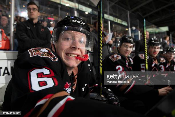 Luke Prokop of the Calgary Hitmen sits on the bench and hams it up for the camera during third period against the Kelowna Rockets at Prospera Place...