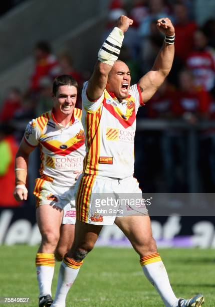 Luke Quigley and Mathieu Griffi of Catalan Dragons celebrate their team's victory at the end of the Carnegie Challenge Cup SemiFinal match between...