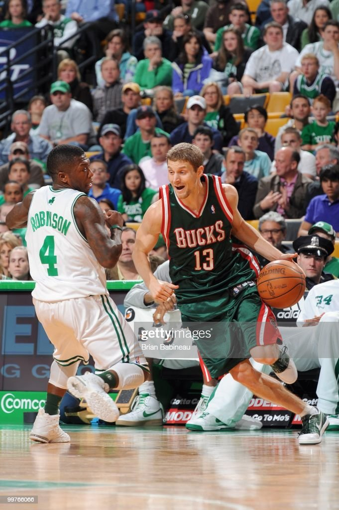 Luke Ridnour #13 of the Milwaukee Bucks drives the ball against Nate Robinson #4 of the Boston Celtics on April 14, 2010 at the TD Garden in Boston, Massachusetts.