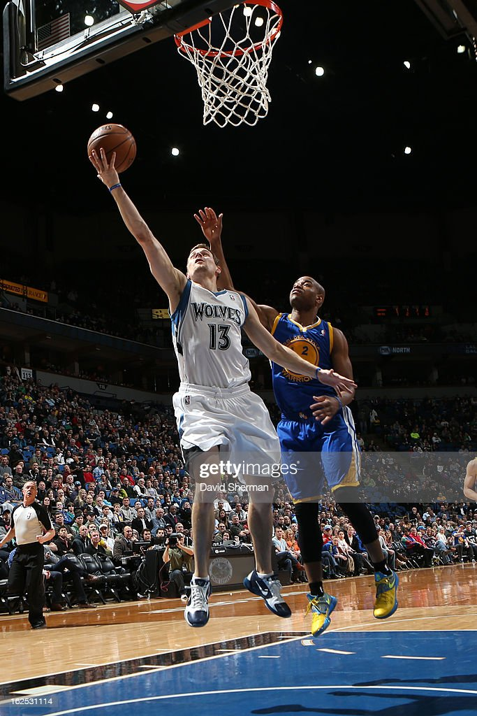 Luke Ridnour #13 of the Minnesota Timberwolves drives to the basket against Jarrett Jack #2 of the Golden State Warriors on February 24, 2013 at Target Center in Minneapolis, Minnesota.