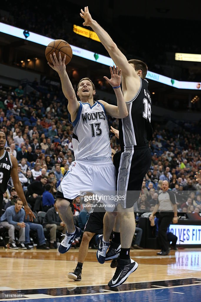 Luke Ridnour #13 of the Minnesota Timberwolves drives to the basket against the San Antonio Spurs on February 6, 2013 at Target Center in Minneapolis, Minnesota.