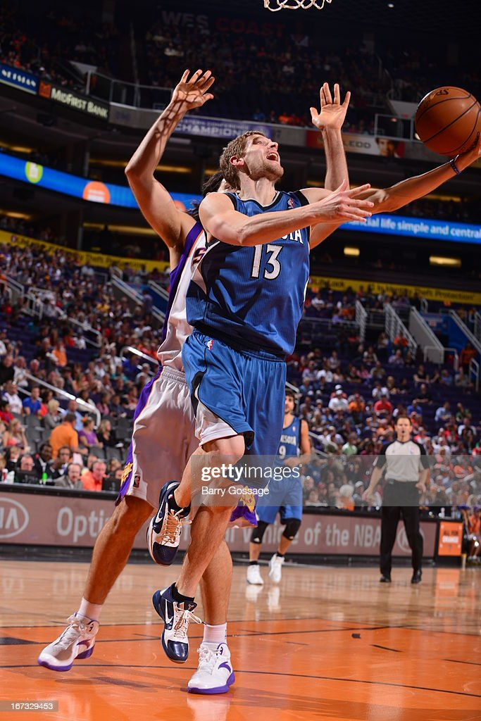 Luke Ridnour #13 of the Minnesota Timberwolves drives to the basket against the Phoenix Suns on March 22, 2013 at U.S. Airways Center in Phoenix, Arizona.