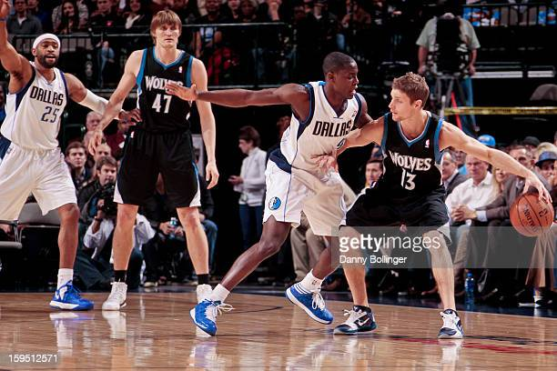 Luke Ridnour of the Minnesota Timberwolves handles the ball against Darren Collison of the Dallas Mavericks on January 14 2013 at the American...