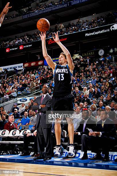Luke Ridnour of the Minnesota Timberwolves shoots a threepointer against the Dallas Mavericks on January 14 2013 at the American Airlines Center in...