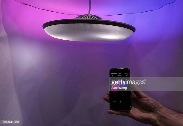 Luke Roberts a smart lamp that can create the mood people want for their room is seen during a press event for CES 2017 at the Mandalay Bay...