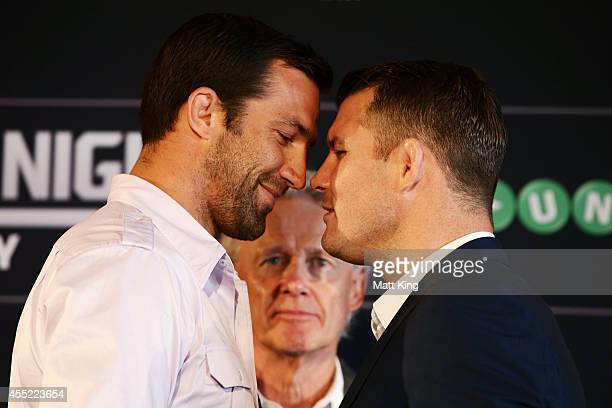 Luke Rockhold and Michael Bisping sqaure off as UFC Managing Director Australia Canada and New Zealand Tom Wright looks on during the UFC Fight Night...