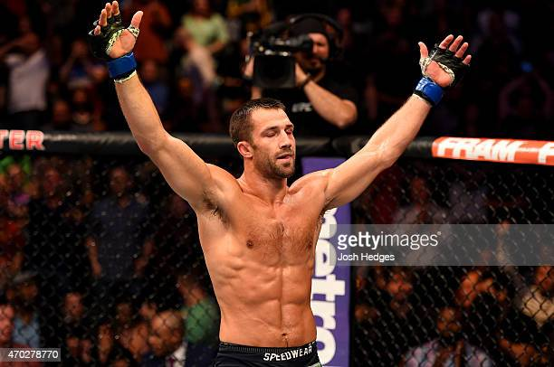 Luke Rockhold celebrates defeating Lyoto Machida of Brazil by tap out in their middleweight bout during the UFC Fight Night event at Prudential...