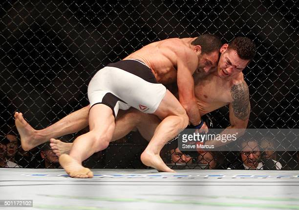 Luke Rockhold takes down Chris Weidman in their middleweight title fight during UFC 194 on December 12 2015 in Las Vegas Nevada